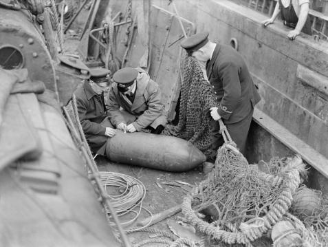 Defusing a bomb, 1941.